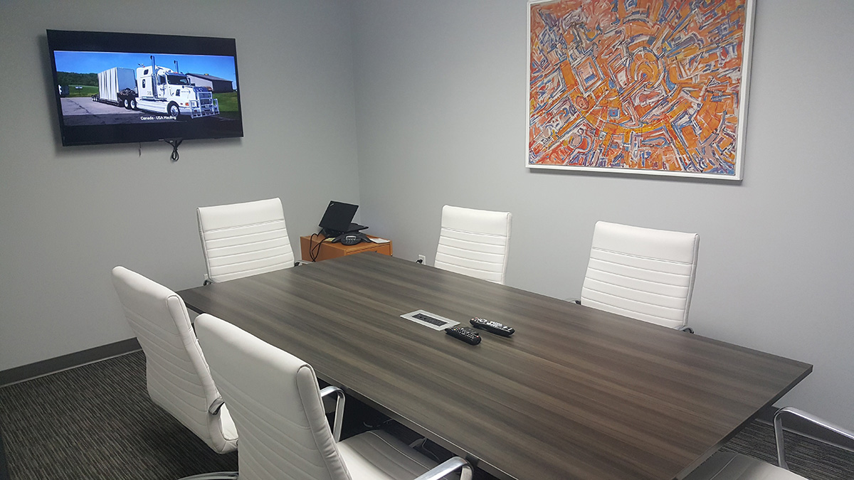 JJ Transport office boardroom with table and tv